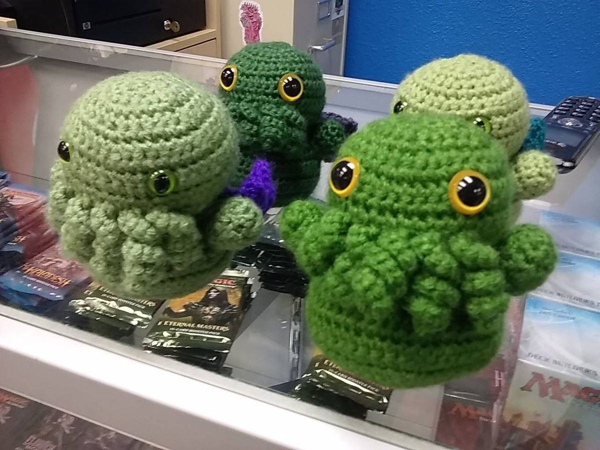 Crocheted creatures with sort of legs and eyes