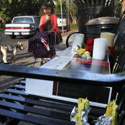 An informal memorial sits on a bench in the Bryn Mawr neighborhood Saturday, Sept. 29, 2012 in tribute to UPS driver Keith Basinski, 50, who was among five victims killed in the shooting rampage that took place late Thursday afternoon at Accents Signage Systems, Inc. in Minneapolis, Minn. Police say Andrew Engeldinger, 36, was fired from the company that afternoon and responded by fatally shooting others there before he turned the gun on himself.