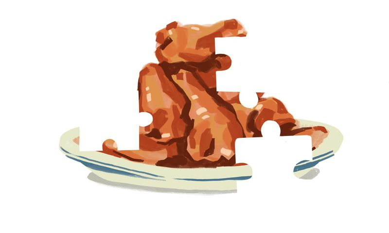 An illustration of food on a plate with puzzle-shaped missing pieces.