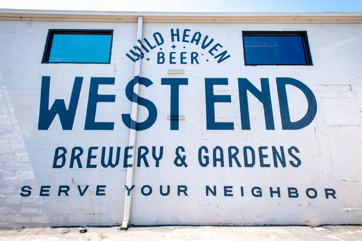 An exterior painting of Wild Heaven's logo in West End
