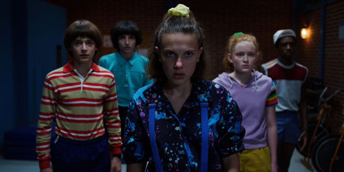 A group of the kids from Stranger Things, facing the camera.