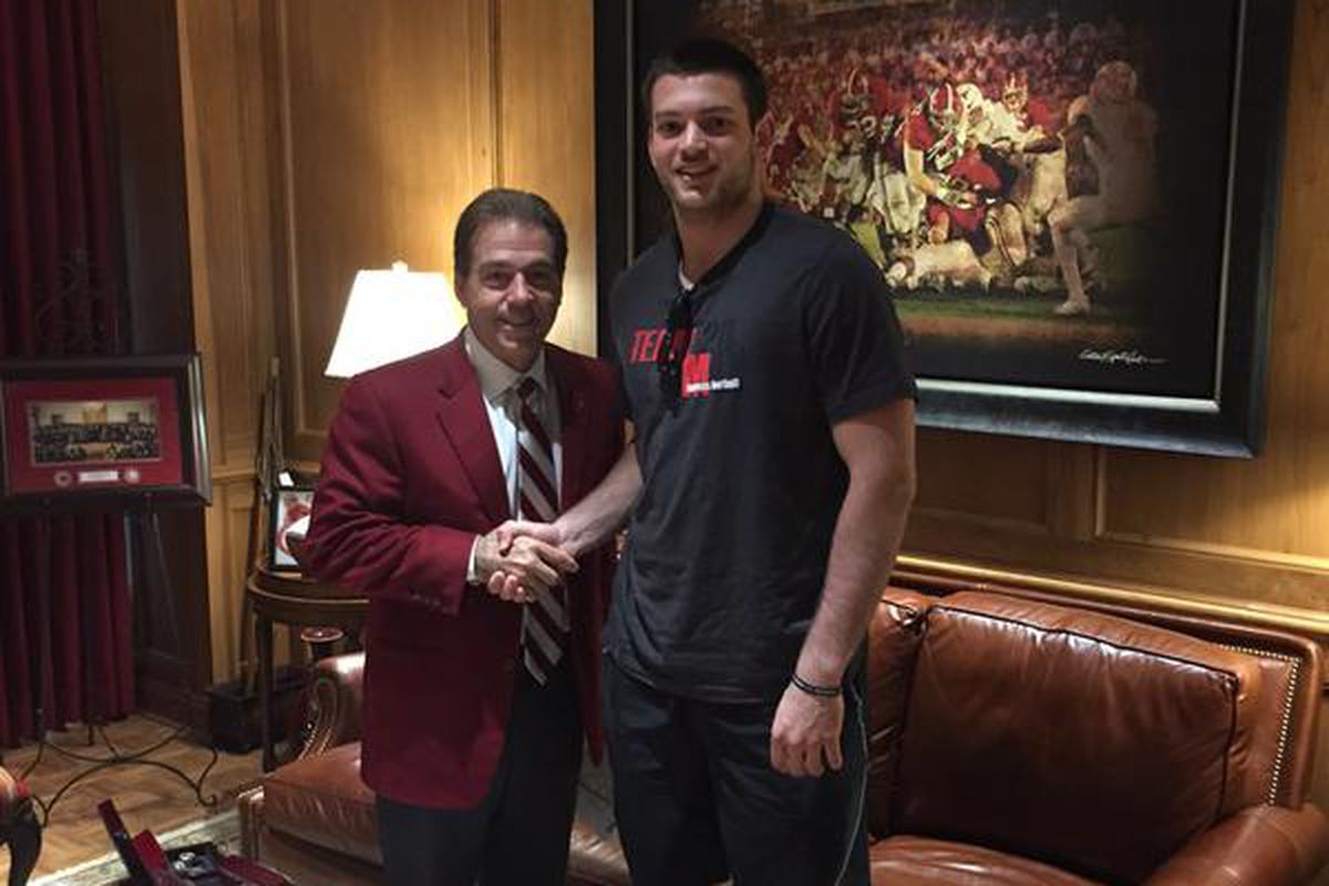 Kaden Smith with one of his many suitors, Nick Saban, in a photo posted to his Twitter page on January 31, 2015