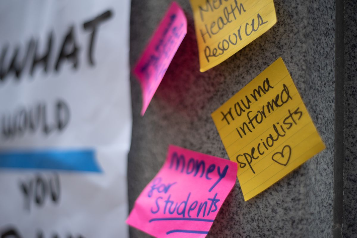 A board of sticky notes shows student ideas for alternatives to police. The board was created during a student protest outside a Board of Education meeting on August 26, 2020.