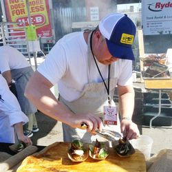 Ford Fry of No. 246 in Decatur, GA, plating chicken feet.