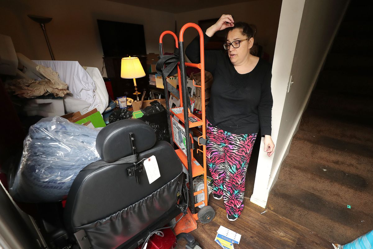 Pam Henderson looks over her belongings as she begins moving out of the apartment she shared with her husband in South Salt Lake on Tuesday, Jan. 12, 2021. The Hendersons were evicted from their apartment.