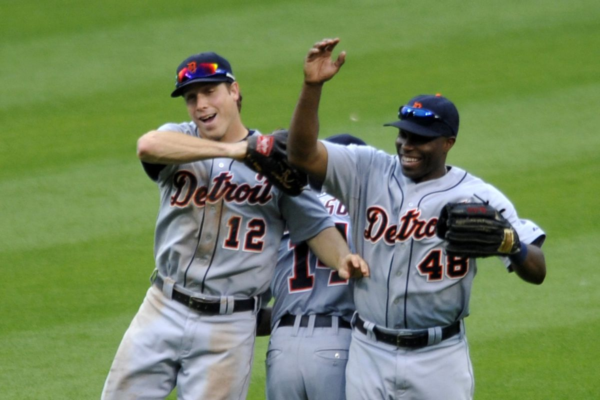 Andy Dirks (12), Austin Jackson (14), and Torii Hunter (48) celebrate after a win.