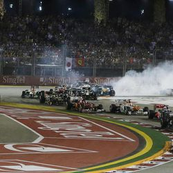 McLaren Formula One driver Lewis Hamilton of Britain leads the field into turn two at the start of the Singapore Formula One Grand Prix on the Marina Bay City Circuit in Singapore, Sunday, Sept. 23, 2012.