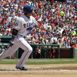 Texas Rangers' Josh Hamilton watches his RBI sacrifice fly against the Chicago White Sox during the first inning of a baseball game Friday, April 6, 2012 in Arlington, Texas.