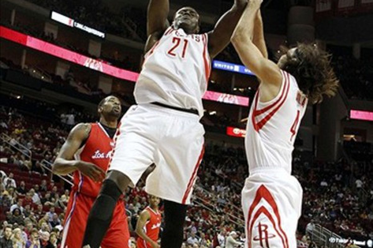 Mar 4, 2012; Houston, TX, USA; Houston Rockets center Samuel Dalembert (21) rebounds the basketball against the Los Angeles Clippers in the first quarter at the Toyota Center. Mandatory Credit: Brett Davis-US PRESSWIRE