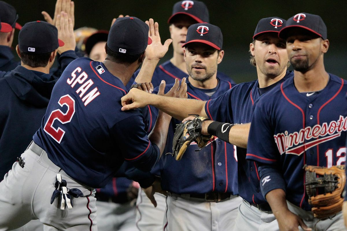 DETROIT, MI - MAY 16: Denard Span #2 of the Minnesota Twins celebrates with his teammates an win over the Detroit Tigers Aat Comerica Park on May 16, 2012 in Detroit, Michigan. The Twins defeated the Tigers 11-7. (Photo by Leon Halip/Getty Images)