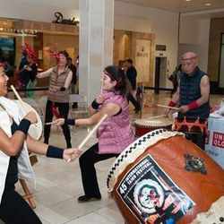 Drumming at the Westfield Valley Fair Uniqlo opening party.