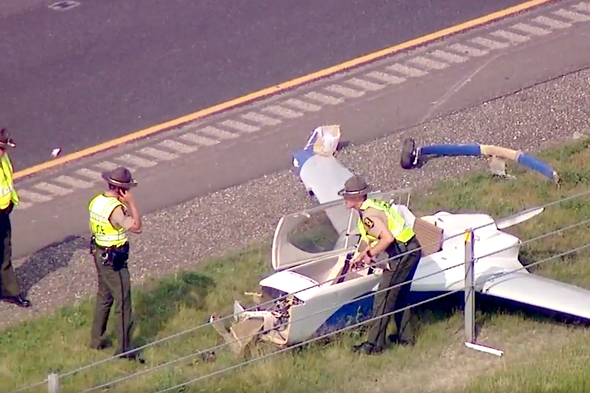 State police investigate a plane that crashed Monday on I-88 in Kane County.