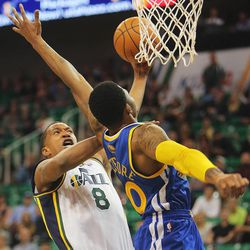 Utah's Dominic McGuire puts up a shot over Warriors' Kant Bazemore as the Utah Jazz and the Golden State Warriors play Tuesday, Oct. 8, 2013 in preseason action at Energy Solutions arena in Salt Lake City.