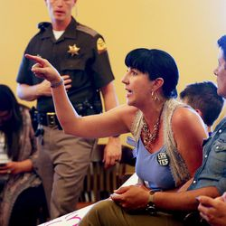 Tina Escobar Taft yells out in protest during a Democratic Party Chairman candidate debate  at the state Capitol in Salt Lake City on Wednesday, June 7, 2017.