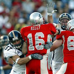 BYU's Jon Burbidge puts pressure on New Mexico QB Casey Kelly.