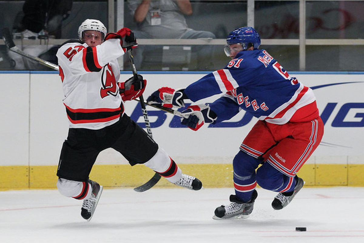 NEW YORK - SEPTEMBER 23:  Ryan McDonagh #51 of the New York Rangers checks Mattias Tedenby #52 of the New Jersey Devils during their preseason game on September 23 2010 at Madison Square Garden in New York City.  (Photo by Al Bello/Getty Images)