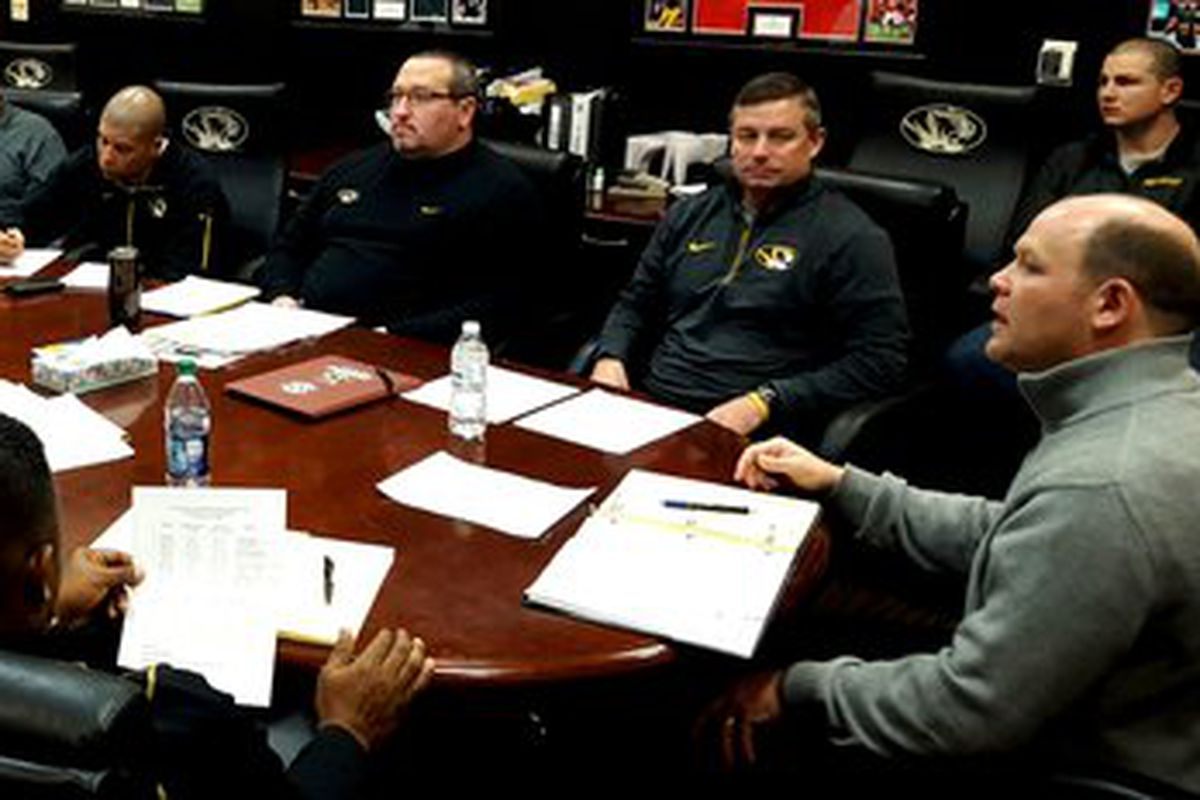 Barry Odom meets with his staff