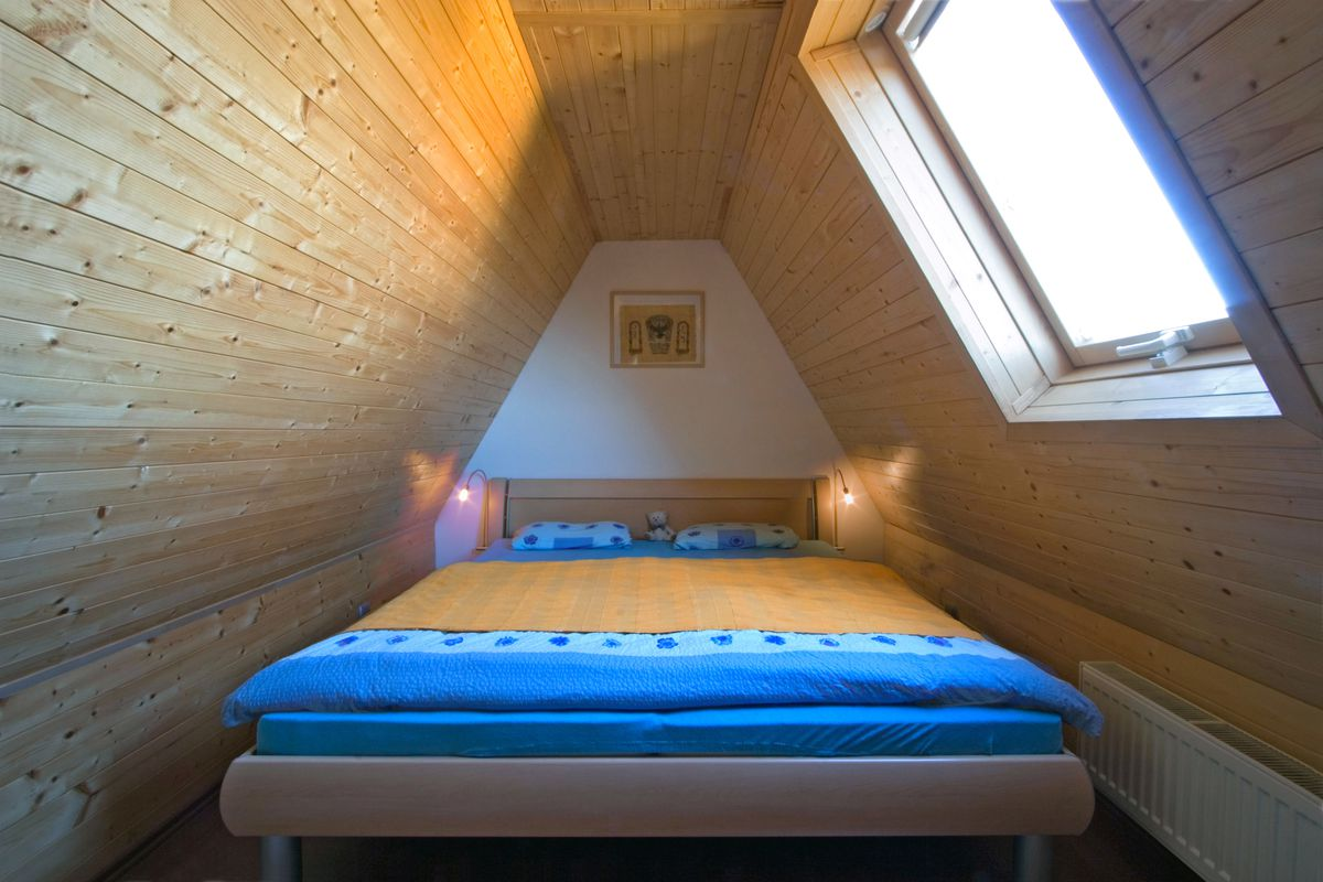 Wood ceiling in attic bedroom.