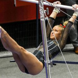 Utah's Abby Paulson performs on the bars as Utah and UCLA compete in a gymnastics meet at the Huntsman Center in Salt Lake City on Friday, Feb. 19, 2021.