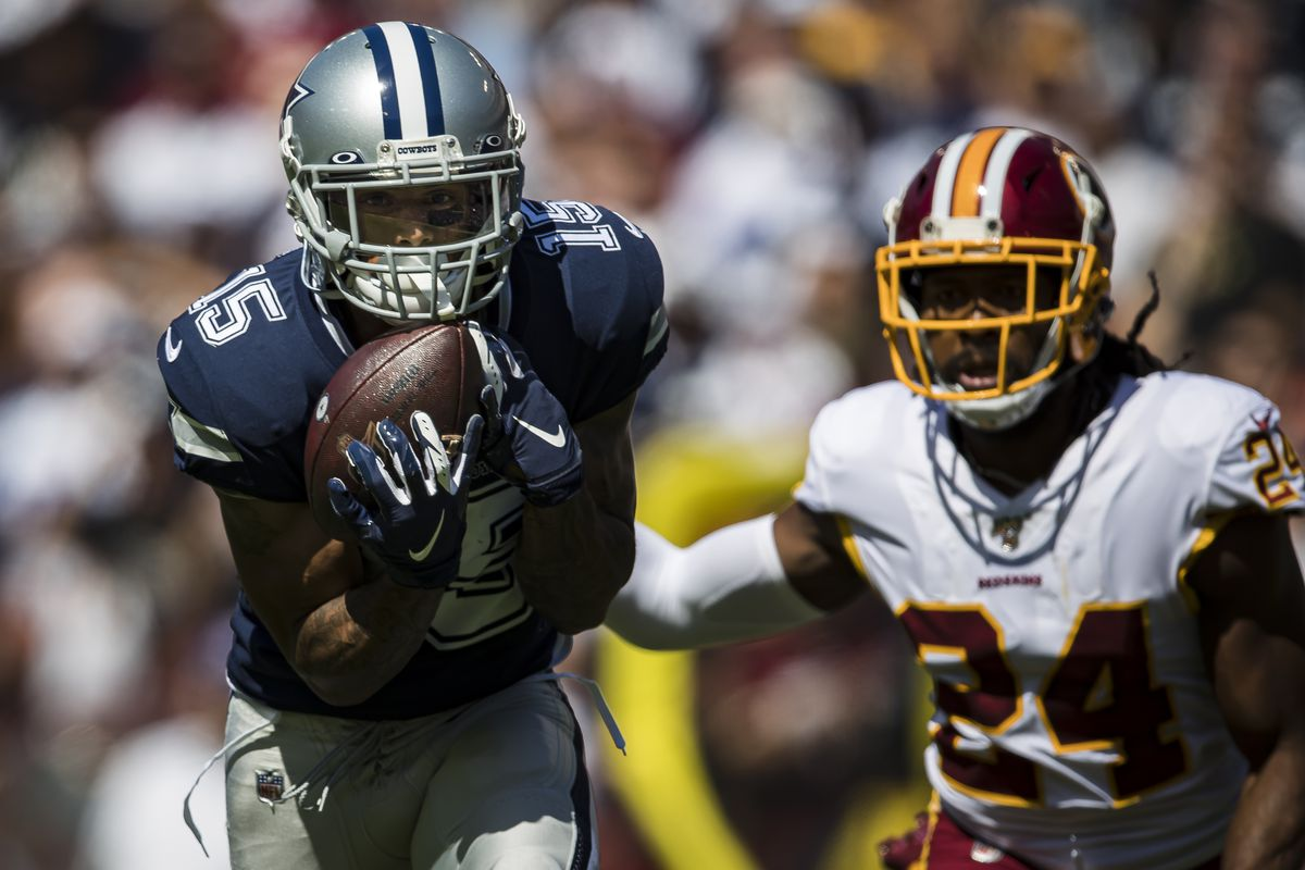 Devin Smith of the Dallas Cowboys catches a pass for a touchdown in front of Washington cornerback Josh Norman during the first half at FedExField on September 15, 2019 in Landover, Maryland.