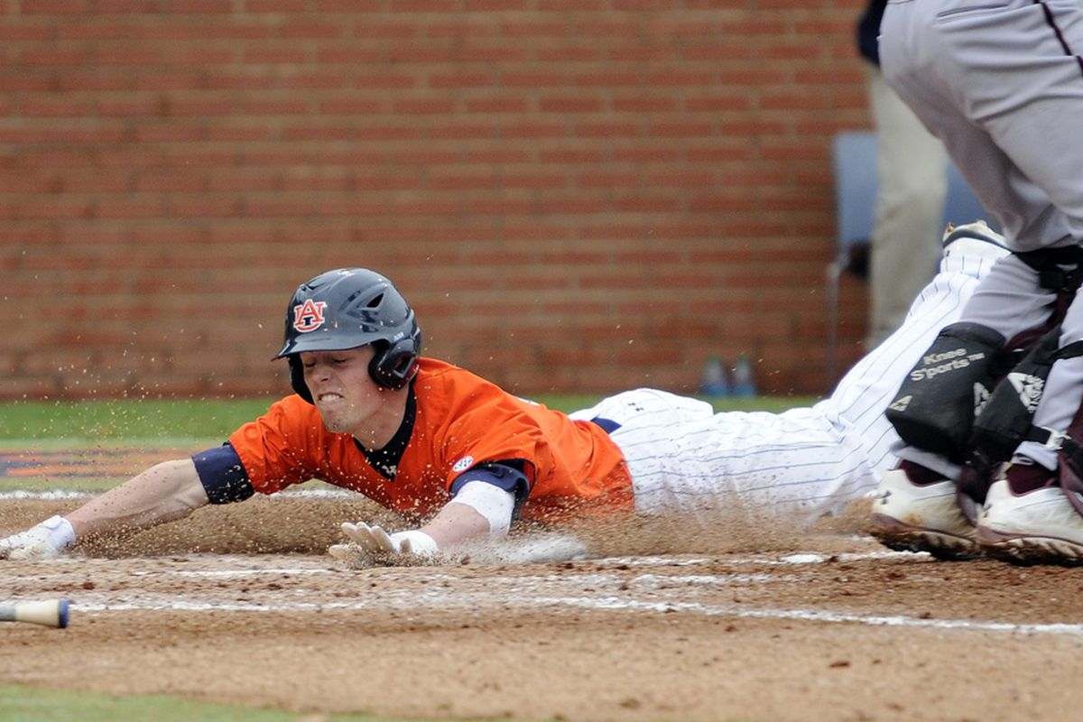 Auburn's Ryan Tella score after hitting a two run inside the park homerun in the third inning against College of Charleston during their college baseball game on Saturday, February 23, 2013 in Auburn, Ala.