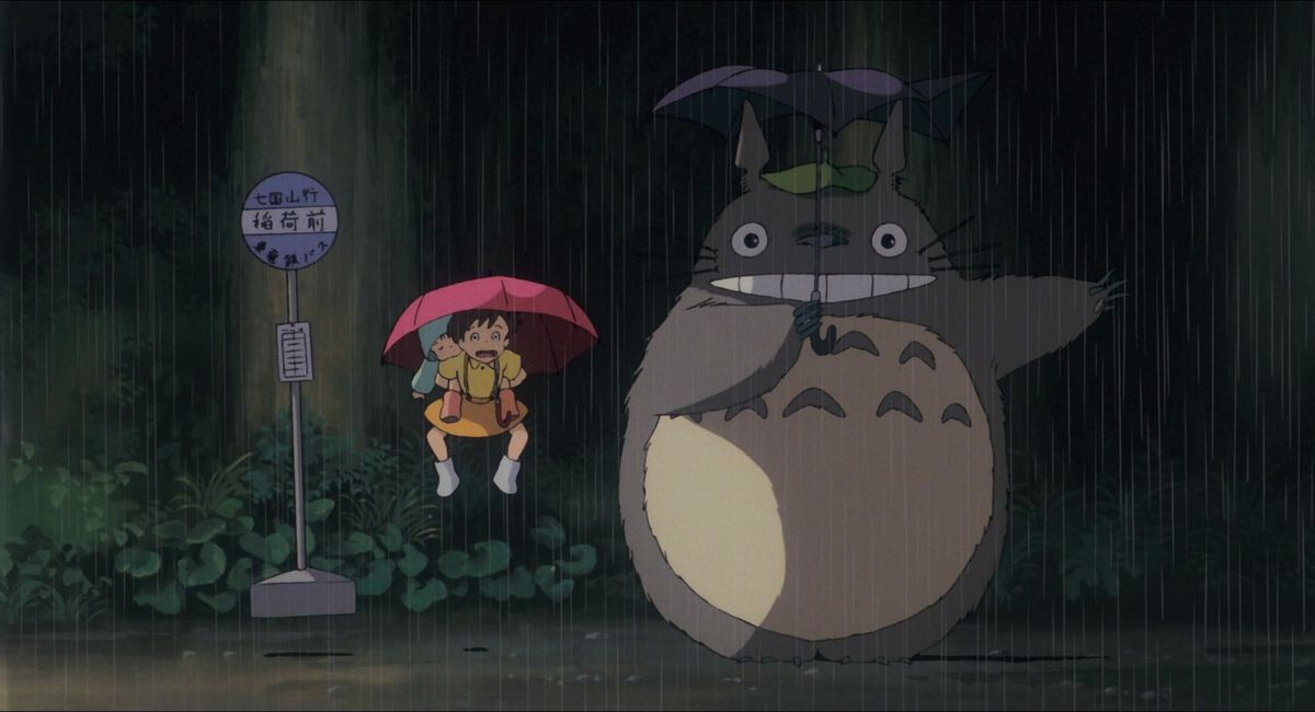 satsuki and mei jump in the air when totoro makes the rain come crashing down