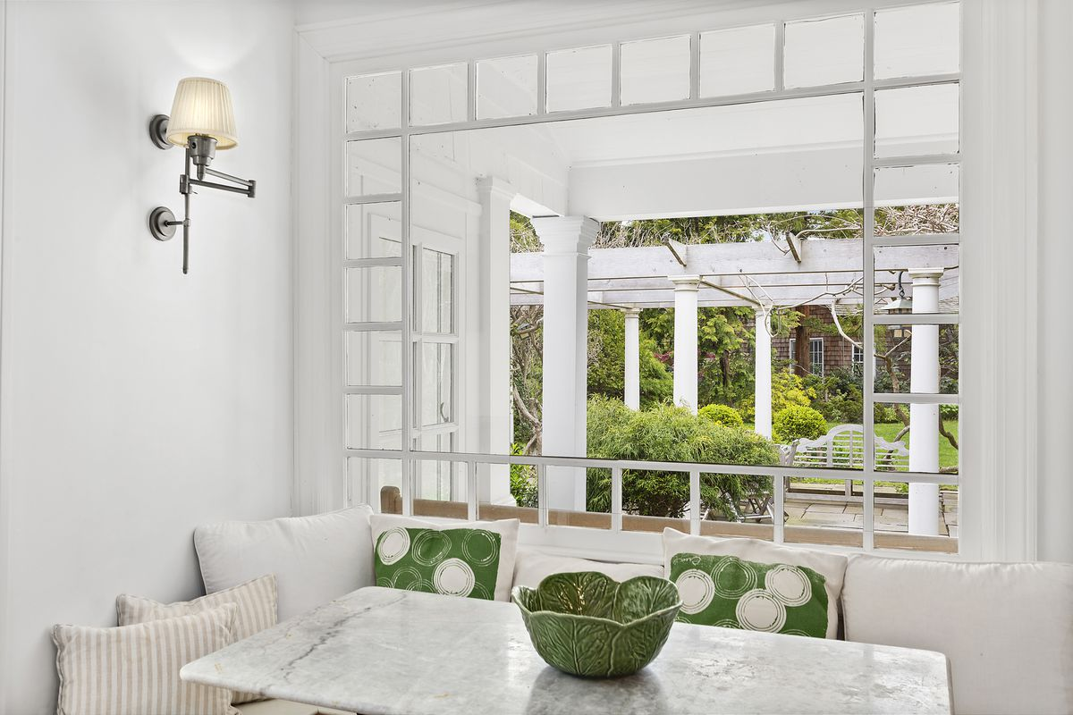 A white marble breakfast book has views out to the garden and pergola.