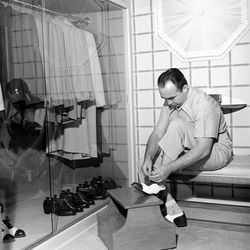 """At home in front of his neatly-organized closet in 1949. Photo via <a href=""""http://life.time.com/crime/mickey-cohen-photos-of-a-legendary-los-angeles-mobster-1949/#18"""">Life</a>."""