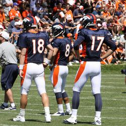 Denver Broncos quarterbacks (L to R) Peyton Manning, Ryan Katz, and Brock Osweiler look on