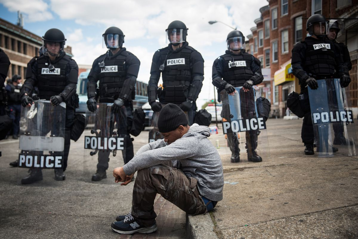 Police watch over protesters in Baltimore.