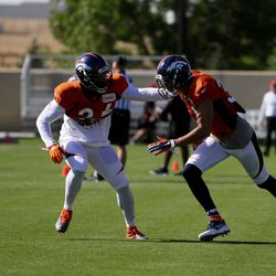 Broncos S Darian Stewart gets a hand on rookie S Justin Simmons during coverage drills.