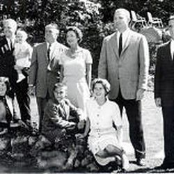 The Romney family in 1959: 12-year-old Mitt sits in front of his parents, George and Lenore.
