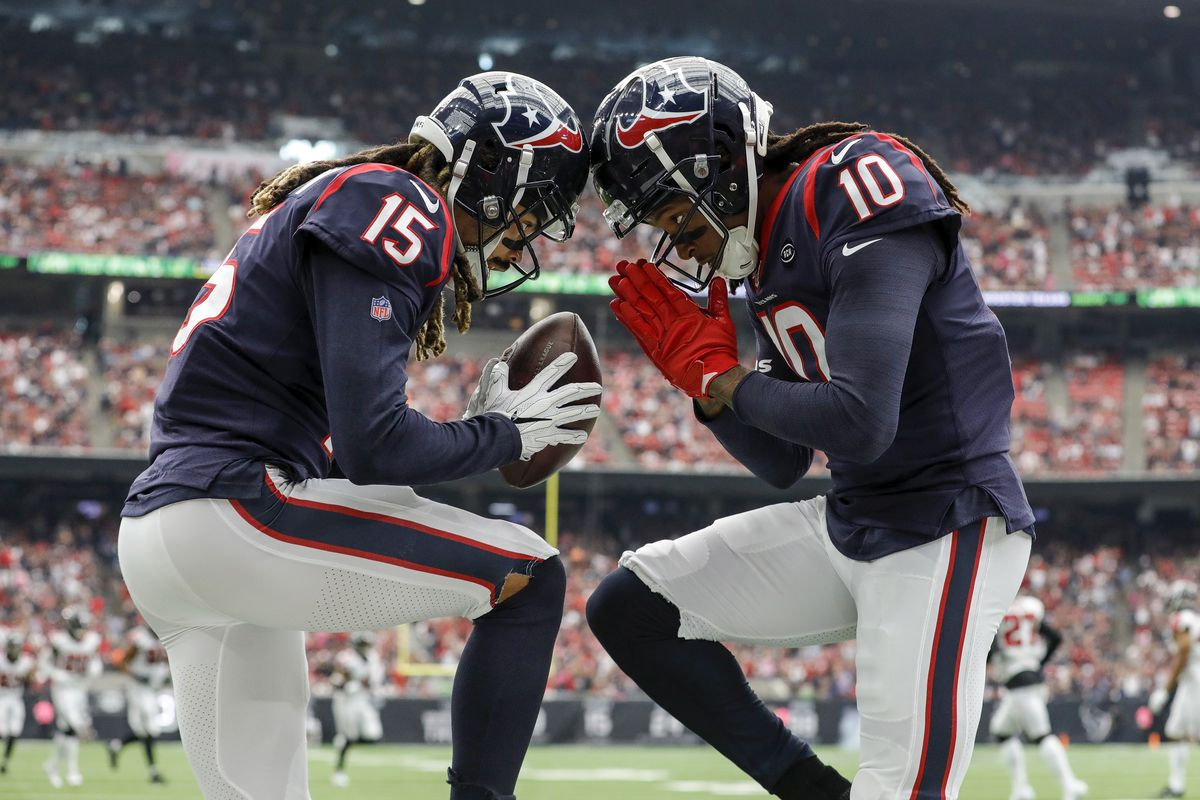 Will Fuller of the Houston Texans celebrates with DeAndre Hopkins after a touchdown in the first half against the Atlanta Falcons at NRG Stadium on October 6, 2019 in Houston, Texas.