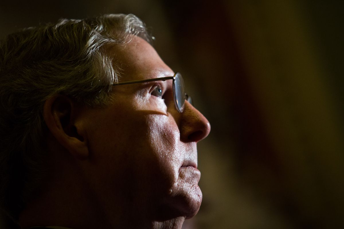 Senate Minority Leader Mitch McConnell (R-KY) looks on during a news conference on Capitol Hill, November 21, 2013, the day after the Senate voted 52-48 to abolish the filibuster for nominations (excepting Supreme Court nominations).