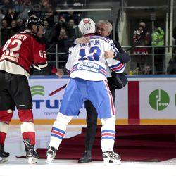 Former Manchester United coach Jose Mourinho, center, is helped by two-time Stanley Cup winner Pavel Datsyuk of SKA St. Petersburg, right, after falling down making the first puck drop at Monday's Kontinental Hockey League game between Avangard Omsk and SKA St. Petersburg in Moscow, Russia, Monday, Feb. 4, 2019. Former Manchester United coach has ceremonially opened an ice hockey game in Russia _ and promptly fallen on the ice. Yevgeni Medvedev of Avangard Omsk is on the left. (AP Photo/Dmitry Golubovich)