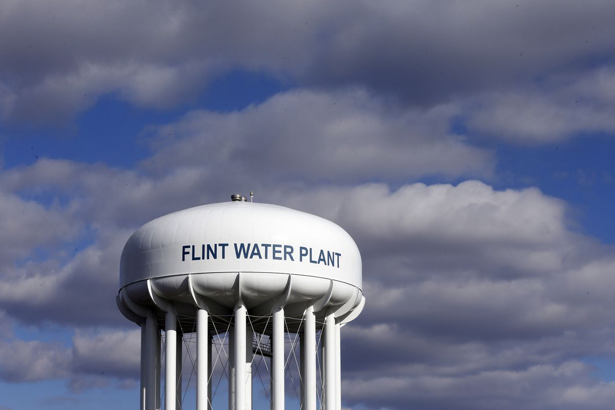 FILE - In this March 21, 2016, file photo, the Flint Water Plant water tower is seen in Flint, Mich. A federal watchdog is calling on the U.S. Environmental Protection Agency to strengthen its oversight of state drinking water systems in the wake of the l
