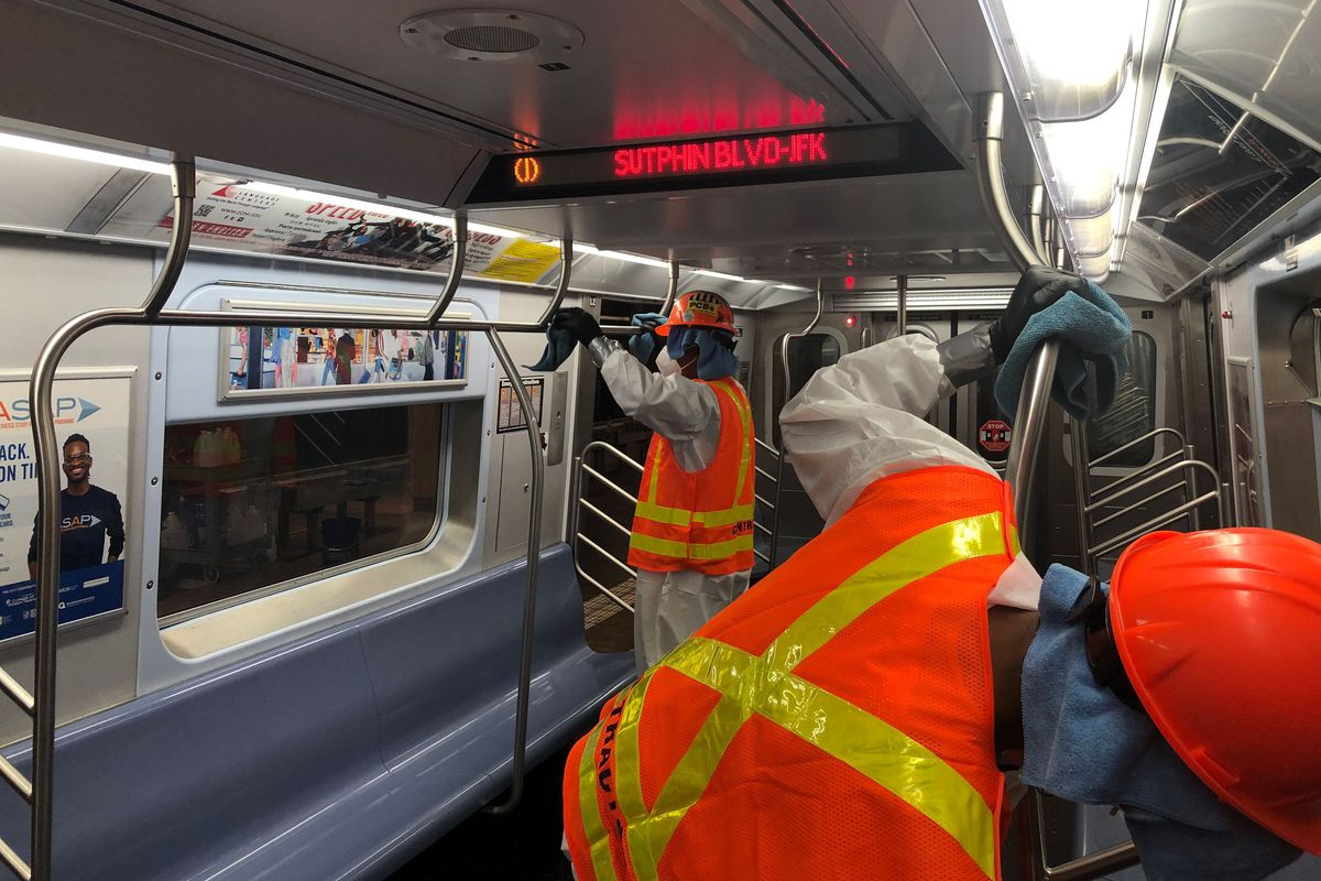 MTA workers clean a subway while the system was closed overnight during the coronavirus outbreak.