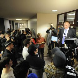 State Sen. Jim Debakis addresses those in the crowd who were unable to receive their marriage licenses as the county clerk's office closed for the night in the Salt Lake County offices after a federal judge ruled that Amendment 3, Utah's same-sex marriage ban, is unconstitutional on Friday, Dec. 20, 2013.