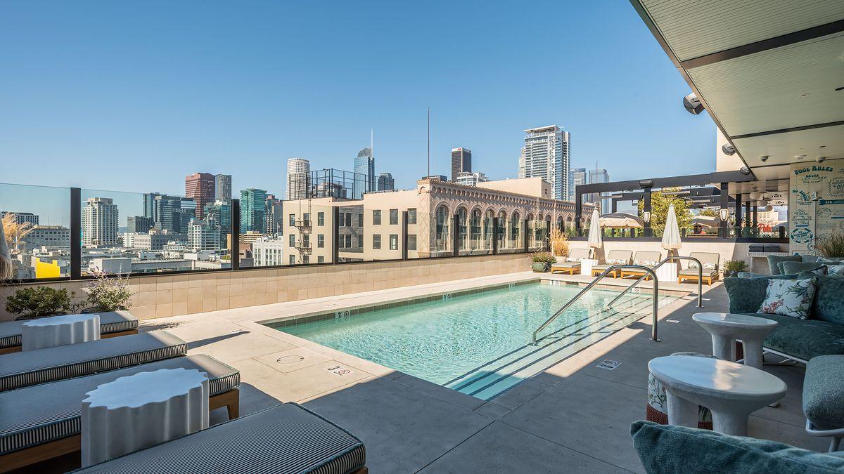 A rectangular rooftop pool overlooking Los Angeles.
