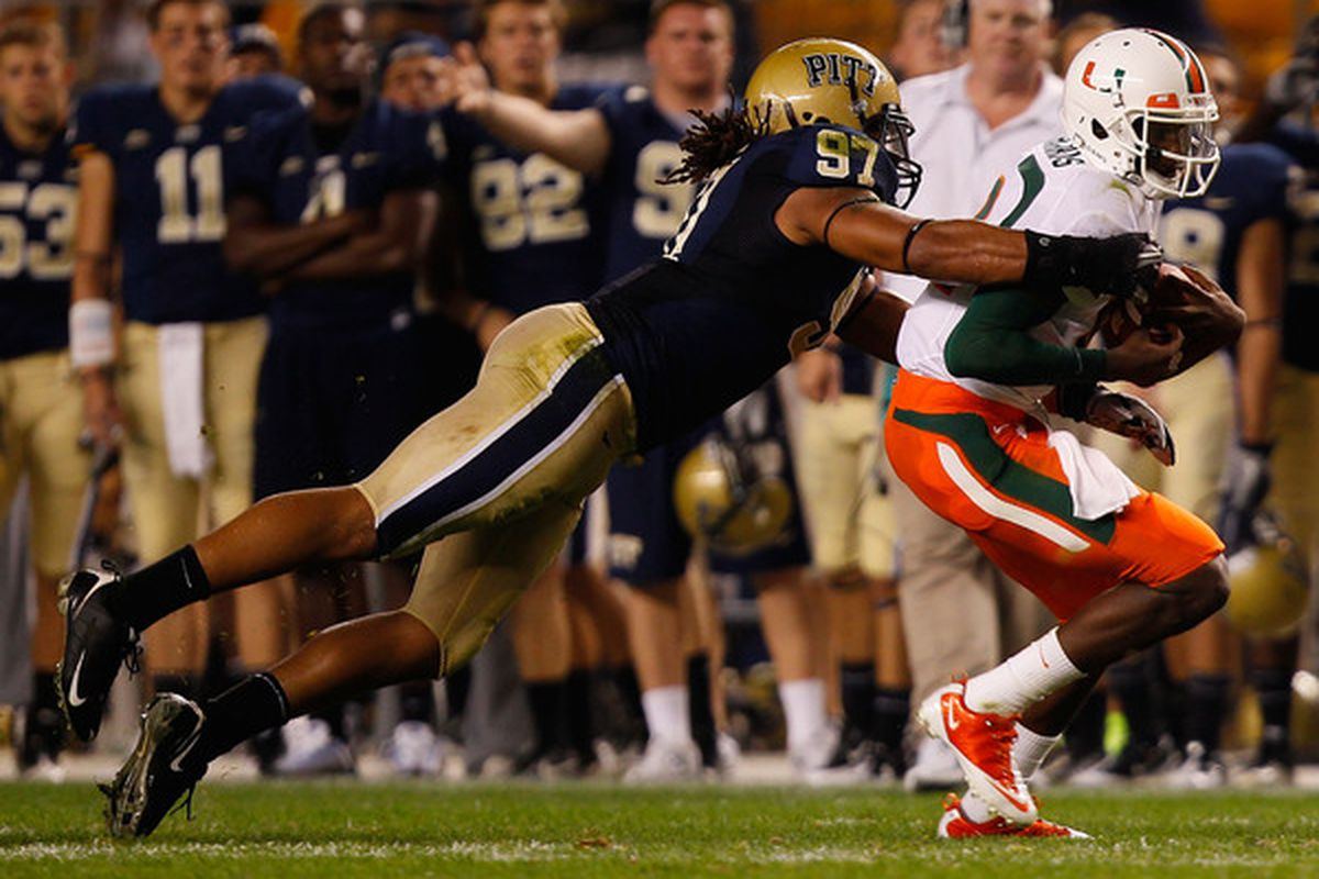 PITTSBURGH - SEPTEMBER 23:  Jacory Harris #12 of the Miami Hurricanes is tackled by Jabaal Sheard #97 of the Pittsburgh Panthers on September 23 2010 at Heinz Field in Pittsburgh Pennsylvania.  (Photo by Jared Wickerham/Getty Images)