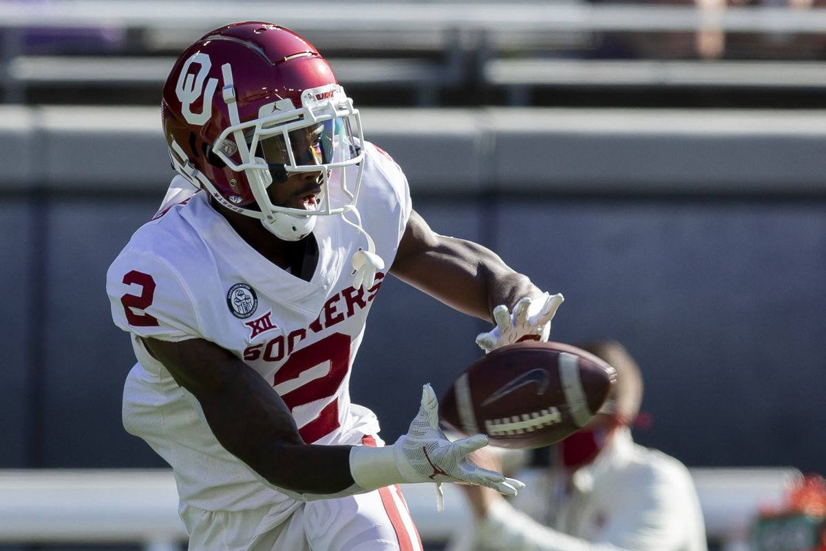 Former Oklahoma Sooners wide receiver Theo Howard, now of the Utah Utes, warms up before a game.