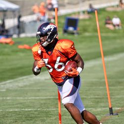 Rookie RB for the Broncos David Williams slaloms through poles at training camp.