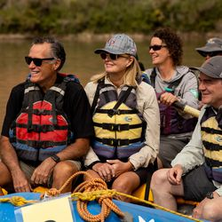 Sen. Mitt Romney, R-Utah, left, his wife, Ann, and Sen. Michael Bennet, D-Colo., sit together in a raft while they float a section of the Colorado River northeast of Moab on Saturday, Sept. 18, 2021.
