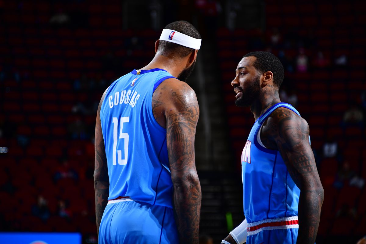 DeMarcus Cousins #15 and John Wall #1 of the Houston Rockets talk during the game against the Sacramento Kings on December 31, 2020 at the Toyota Center in Houston, Texas.