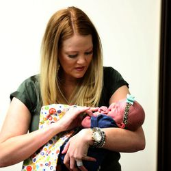 Arlee Gregerson holds her newborn, Lucy, at the Intermountain Medical Center in Murray on Thursday, Dec. 17, 2015. Two days after delivering her first child, Gregerson nearly died. Gregerson returned to the medical center to speak to reporters about her care at the center.