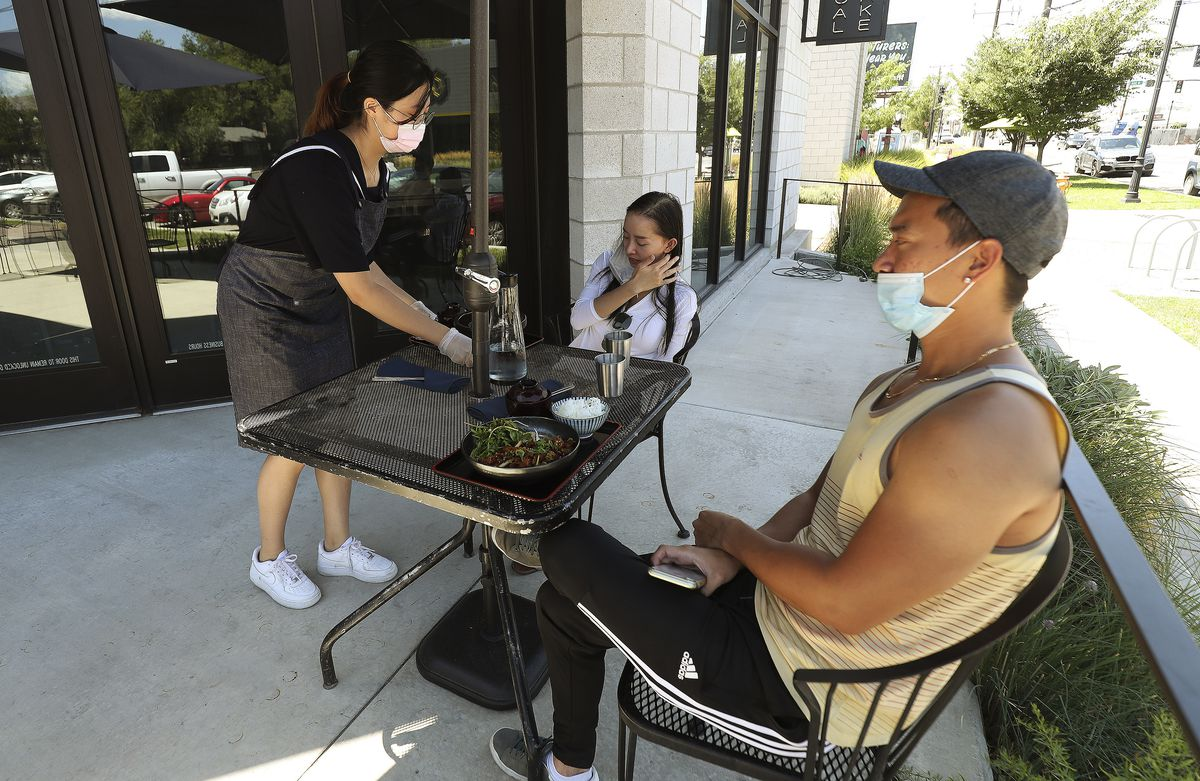 Nicholas Huynh and Kathy Nguyen are served their meal by server Ellie Lee atNohm in Salt Lake City on Tuesday, July 28, 2020. Salt Lake County Mayor Jenny Wilson announced an expansion of the Small Business Impact Grant program to a variety of businesses hurt by COVID-19.