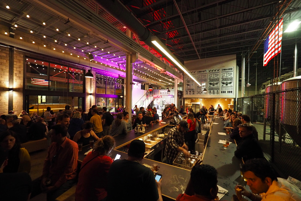 A crowded tap room, in low light