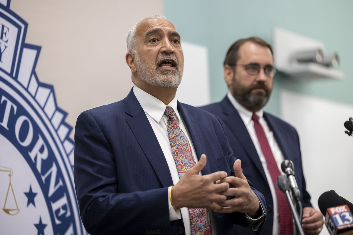 Salt Lake County District Attorney Sim Gill, left, discusses the death penalty in Utah.