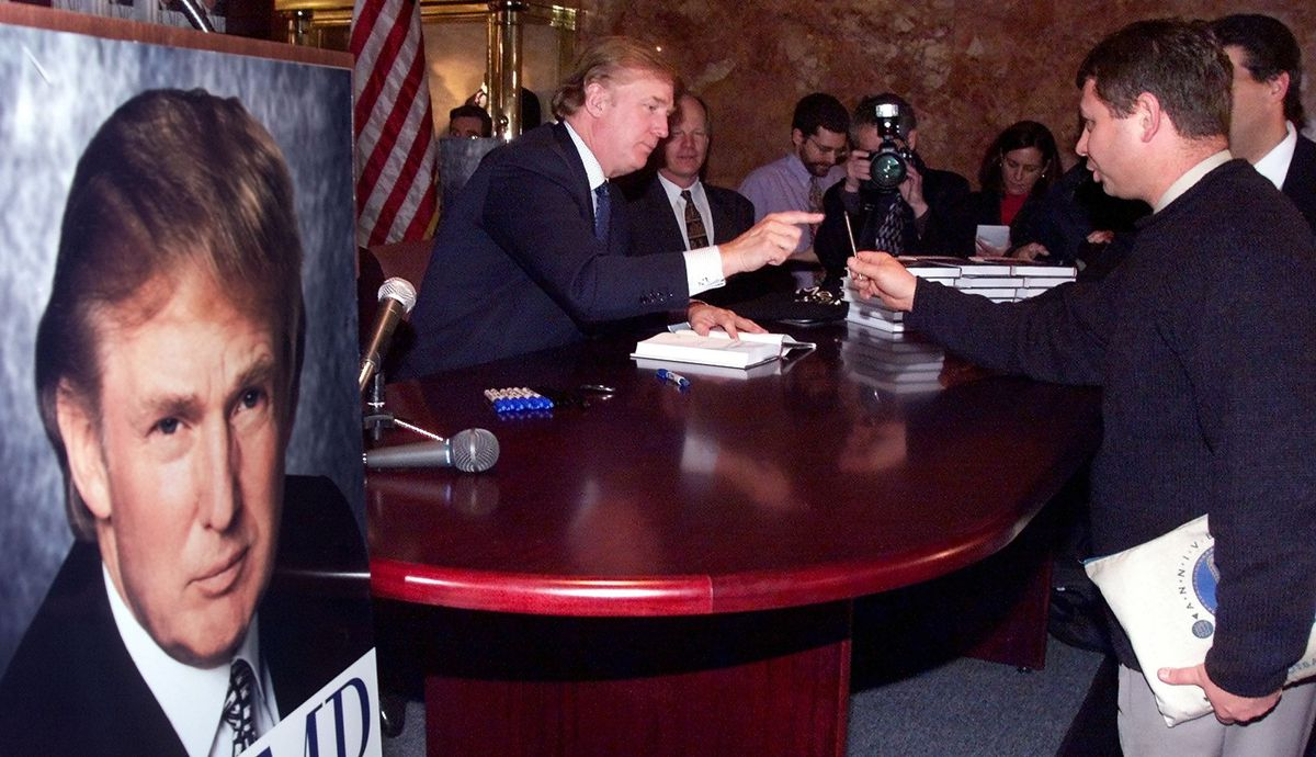 Donald Trump signs copies of his 2000 book, The America We Deserve.