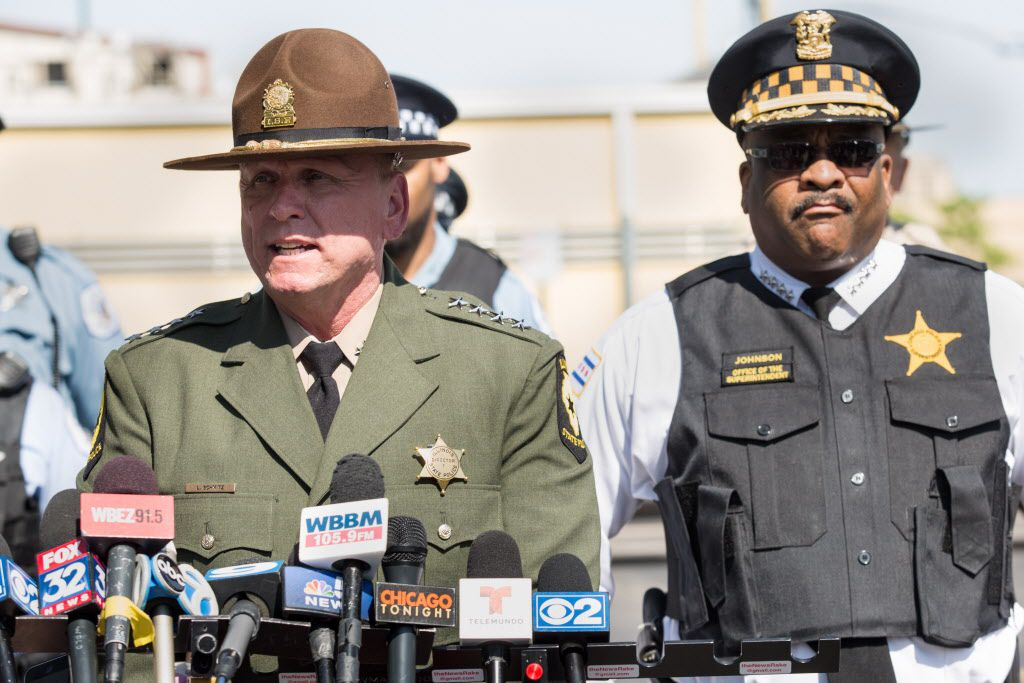 Illinois State Police Director Leo Schmitz, flanked by Chicago Police Supt. Eddie Johnson, speaks to the media Thursday about the upcoming Memorial Day weekend.   Lou Foglia/Sun-Times
